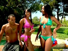 Two slim ebony babes get fucked by White dude in a pool