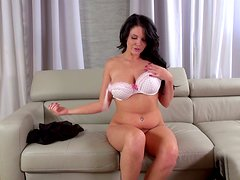 Buxom sexpot Emma Leigh strips and plays with her pussy