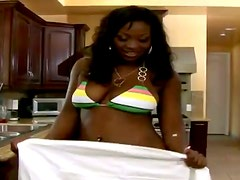 Aryana Star gets her ebony cunt fucked by a horny stud in the kitchen