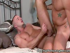 Muscular star tattood hunk gets a cock deep in his throat