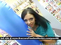 Young brunette pornstar in a sex shop