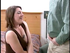 Amateur milf is having fun with three men at a time