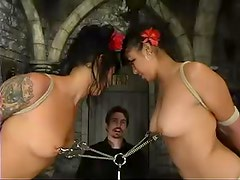 Two brunette chicks get bound and humiliated in a basement