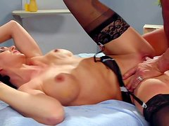 Nurse Roxanne Hall with fit body and big fake tits