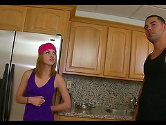 Horny blonde teen jerks a guy in her kitchen