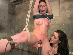 One Girl Having Fun with Two Lesbians in Femdom Bondage Toying Video