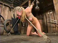 Harmony gets her cunt smashed with a dildo in BDSM scene