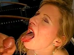 Blonde with red lips is swallowing big loads