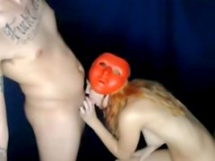 Girl with funny mask blows her boyfriend