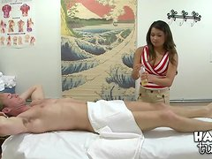 Asian Babe With Fake Tits Giving an Arousing Rub Down