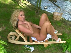 Charming blonde Silvia Saint plays with her pussy in the garden