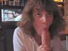 Curly haired young wife showing her blowjob skills