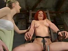 Redhead milf Venus May gets tormented by a sexy blonde