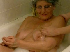 Four eyed granny gets her hairy pussy teased by her lesbian friend