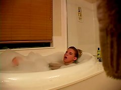 Horny blond is rubbing her cunt in the bathtub