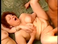 Two dark-haired fatties share a handsome guy's dick indoors
