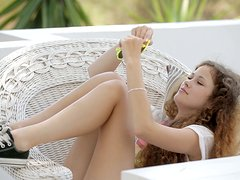 Curly-haired babe Vanessa enjoys fingering her vag outdoors