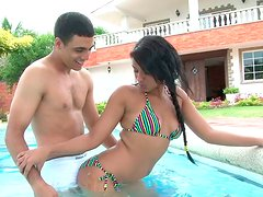 Juicy Latina teen has fun with her bf in pool showing off her booty