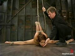 DragonLily gets her Asian cunt toyed hard in BDSM scene