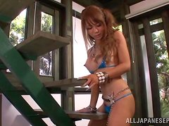 Asuka Hoshino enjoys playing with her hairy snatch indoors