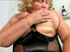 Blonde granny Grace licks her big tits and fingers her meaty cunt