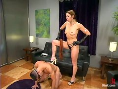 Kym Wilde fucks Marc Bowman's ass with a strapon before beating him