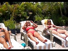 Horny milfs have a lesbian threesome on a patio