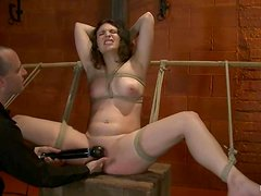 Sienna gets her pussy fingered and toyed in a hot BDSM scene
