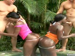 Two ebony skanks get unforgettably fucked on the poolside