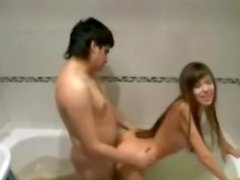 Sexy girlfriend playing in the bathroom with her boyfriend