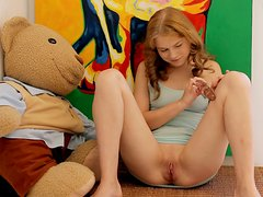 Redhead teen Ksenija A moans sweetly while toying her asshole