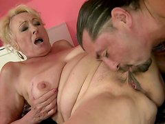 Chubby old whore gets fucked in missionary position