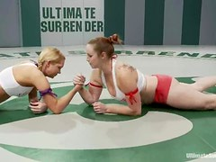 Two girls wrestle in a ring and fuck in a bathroom