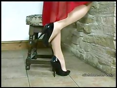 Hot Milf dangles stilettos and teases her nylon legs
