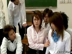 Slender Japanese teacher is in a group sex with her class
