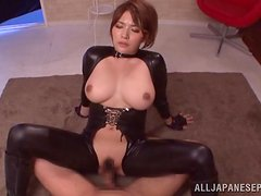 Booty and busty Asian doll in leather suit rides a big one