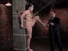 A chubby brunette enjoys weights on her tits and gets her snatch toyed