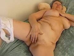 Fat granny with big tits fondles her shaved twat with vibrator