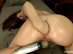 Brunette Tiffany Doll fists her ass and gets toyed