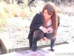 Japanese milf blows and gets fucked in a public bathroom