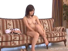 Petite Eichi Hoshikaw shows and gapes her hairy pussy
