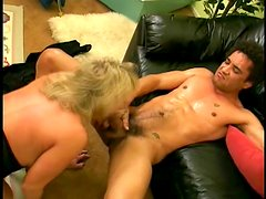 Busty blonde milf jumps on a black cock after sucking it hungrily