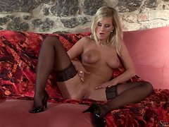 Gorgeous blonde Merry Queen pleases herself with fingering