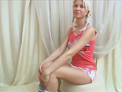 Hot Blonde With Pigtails Poses her Big Tits and Shaved Pussy