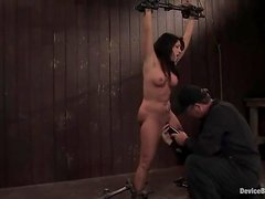 Brunette with big tits gets suspended and vibrated