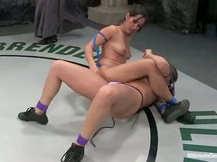 Isis Love toys Ava Devine with a strap-on during a fight