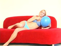 Amazing blonde chick Allie enjoys playing with balloons in solo clip