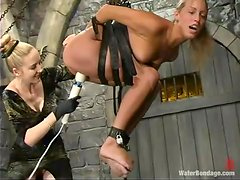 Cassie gets her cunt toyed and showered in BDSM clip