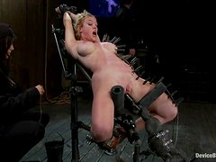 Darling gets pinched and fucked by a sex machine in BDSM vid