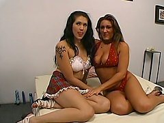 Two girls in miniskirts and lingerie toy their wet pussies